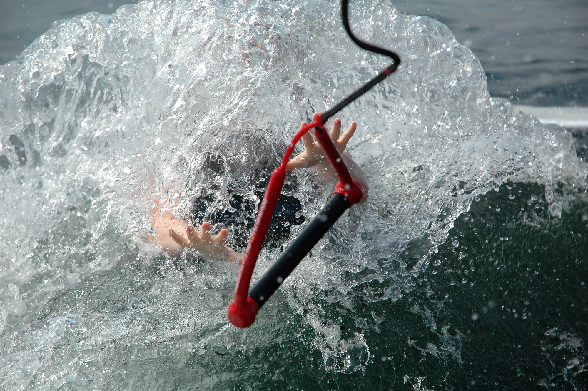 Rope being thrown to help drowning person.