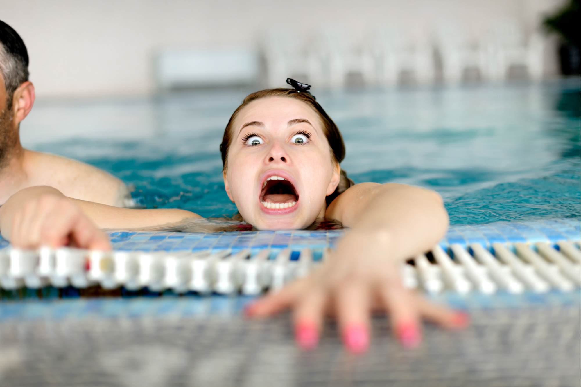 Woman drowning in swimming pool.